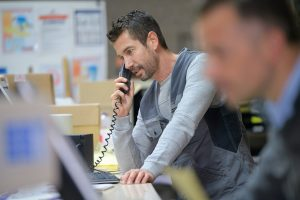 businessman on phone at warehouse