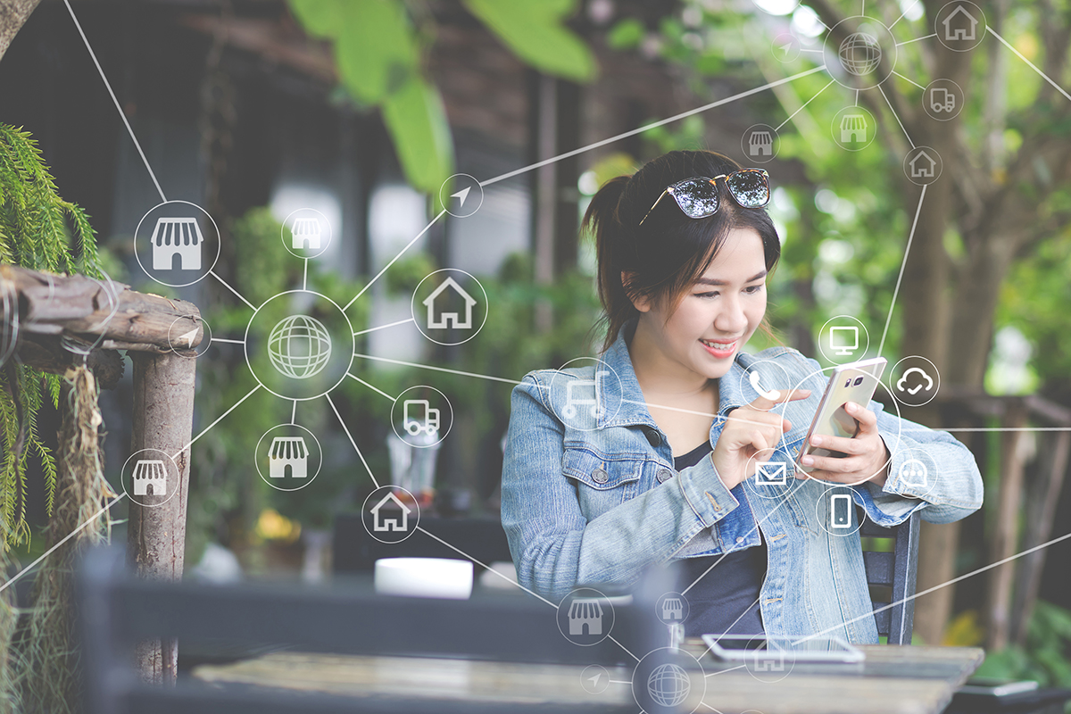 Woman using mobile payments online shopping and icon customer network connection on screen, m-banking and connecting with omni channel vendor. Internet of thing, Multi-channel or Omni channel concept.