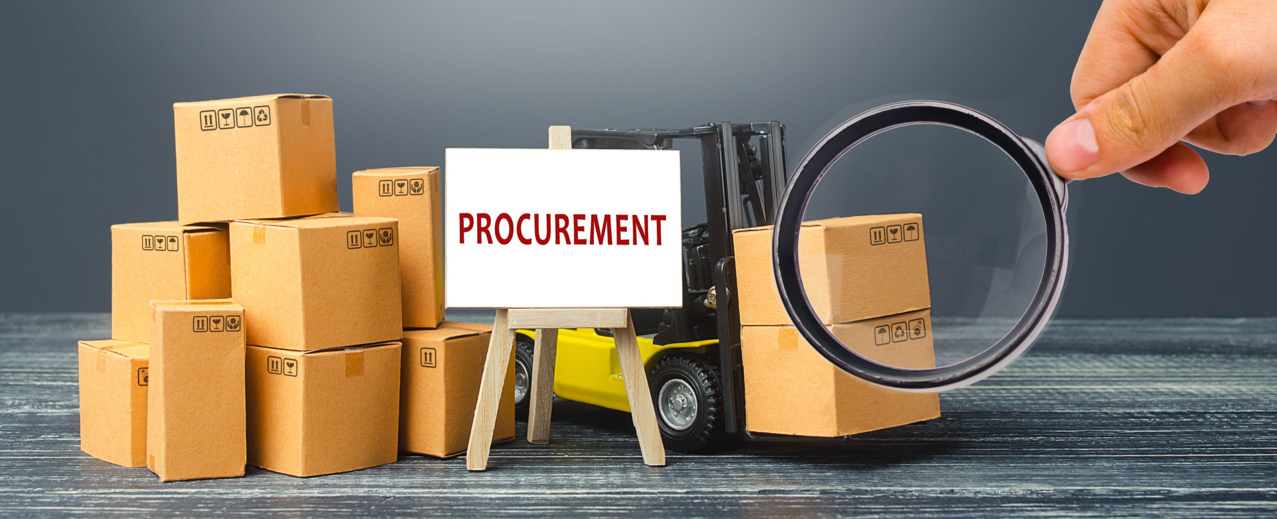 Yellow Forklift truck with cardboard boxes and stand with the word Procurement. Logistics, warehousing, transportation of goods, inspection and storage. Procurement management industry concept.
